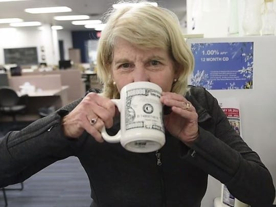 Mary Hance takes a sip of her Ms. Cheap Latte.