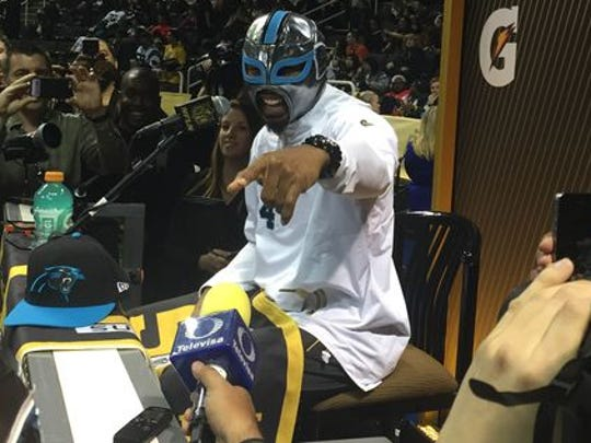 Panthers' Josh Norman dons a wrestling mask during Super Bowl 50 Opening Night.