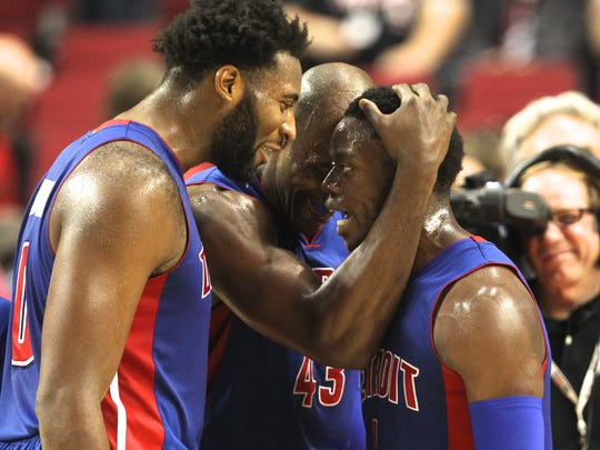Reggie Jackson, right, celebrates with Andre Drummond,