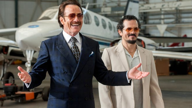 "Bryan Cranston (left, with John Leguizamo) plays a 1980s undercover drug agent playing for big stakes in ""The Infiltrator."""