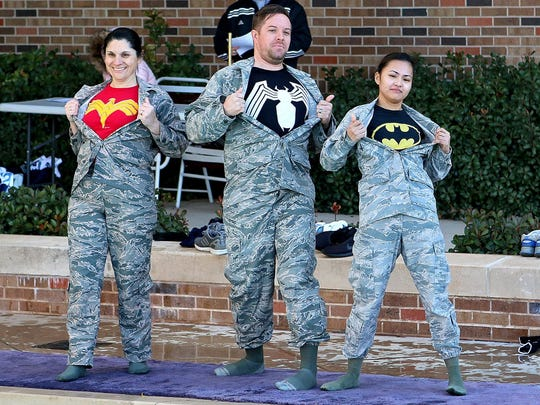 In this 2017 photo, members of the Ice Medics show off their costumes before jumping into the Midwestern State University Wellness Center pool as part of the Polar Plunge. The 2018 event will be moved to Boomtown Bay in Burkburnett.