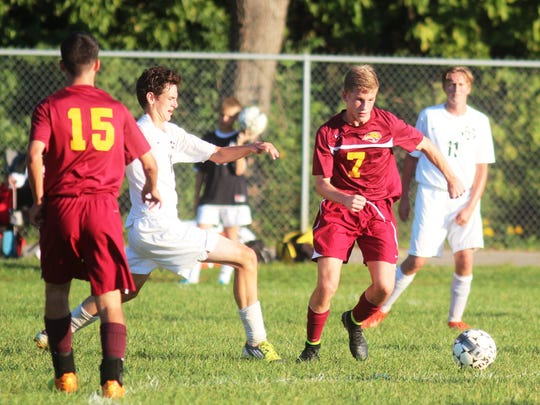 Cooper's Adam Snow, No. 7, controls the ball.