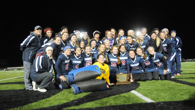 Eastern's Field Hockey team gathers for a picture after winning the State Group IV Championship by defeating Bridgewater-Raritan 5-1 Saturday afternoon.   Photo / Curt Hudson