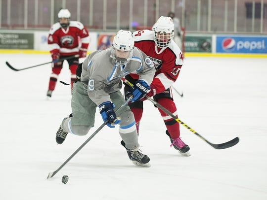 South Burlington's Josh Phillips (9) skates down the