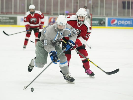 South Burlington's Josh Phillips (9) skates down the