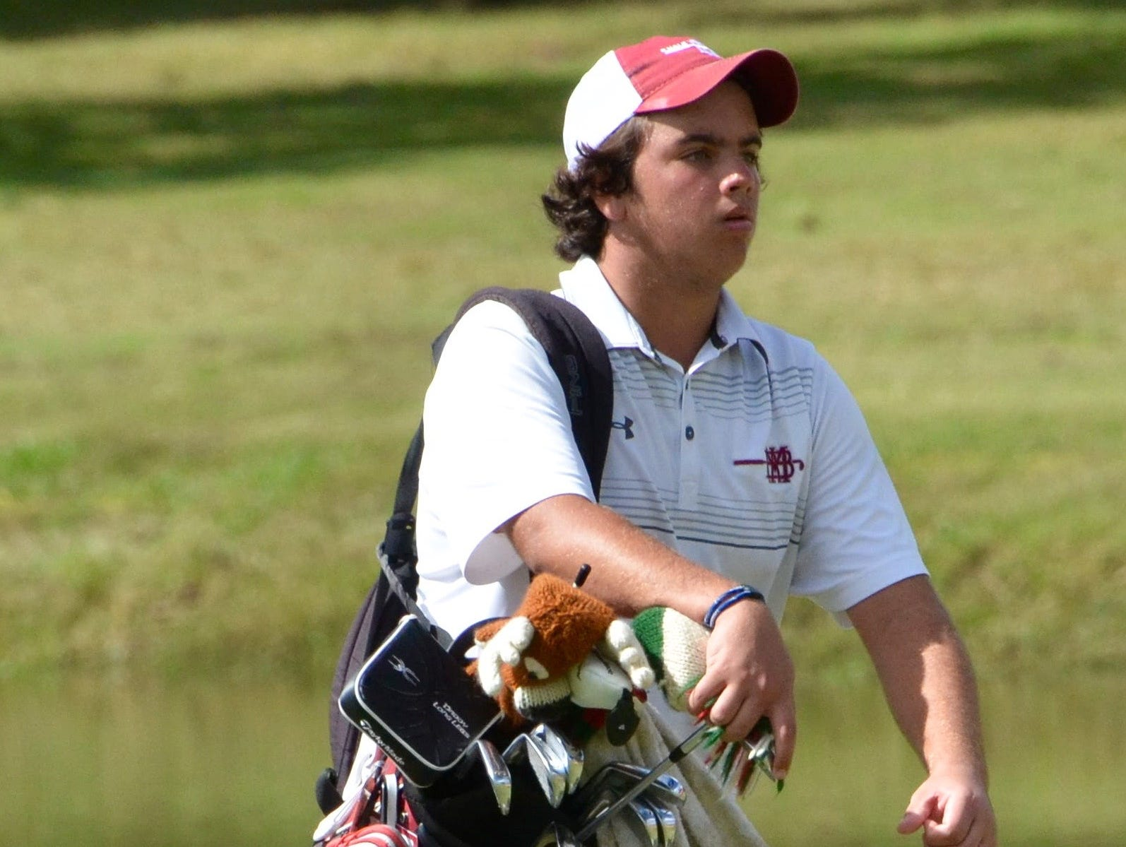 MBA's Josh Morris makes his way to the 18th green during Tuesday's championship round.