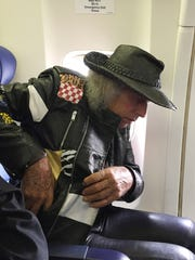Jimmy Goldstein takes his seat on a Southwest flight