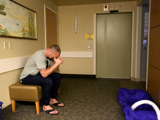 Mike McShane waits as Kyle Atkinson receives radiation therapy at Oregon Health and Science University on Thursday, July 2, 2015, in Salem, Ore.