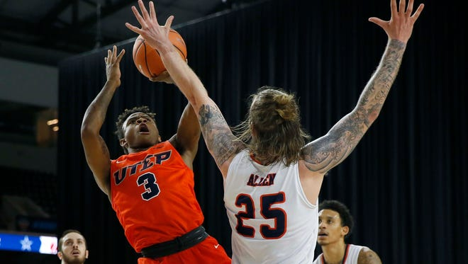 Evan Gilyard pulls up for a jump-shot against UTSA in the first round of the Conference USA Tournament. The Miners were eliminated.