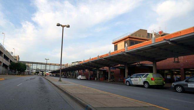 Vehicles park at the drop zone outside the terminal at the Des Moines International Airport.