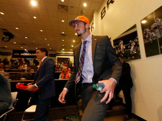 Denver Broncos' first-round selection in the NFL football draft quarterback Paxton Lynch, right, from Memphis, is introduced Friday, April 29, 2016, in the team's headquarters in Englewood, Colo. (AP Photo/David Zalubowski)