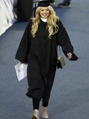 Republican presidential candidate Donald Trump's daughter Tiffany Trump departs after walking across the stage at her graduation ceremony, Sunday, May 15, 2016, at the University of Pennsylvania in Philadelphia. (Matt Rourke)