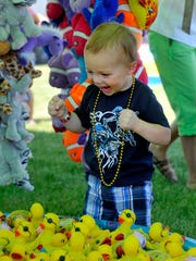 In this 2011 photo, Braedyn Deupree plays the Duck Pond game at the Central Montana Fair in Lewistown.