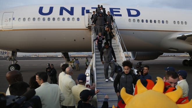Penn State players, coaches and family arrive at Phoenix Sky Harbor International Airport on December 23, 2017 in Phoenix, Ariz.