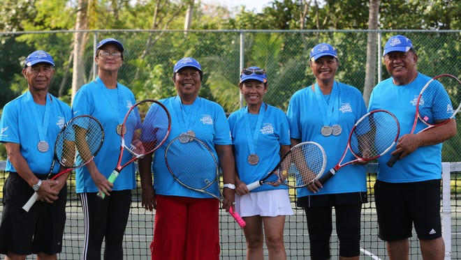 Tennis players from Guam who recently competed at the 9th World Masters Games in Auckland, New Zealand pose for a group photo at the Rick Ninete Tennis Center in Hagåtña upon returning from the Games. The group brought home seven medals from various tennis events at the Games. From left to right are Ricardo Estella, Arlene Diaz, Melodia Pugh, Diane Lee, Rosalie Cao, and Taina Tapu.
