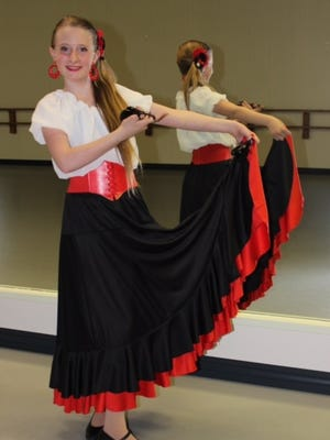 """Madeline Brunsma, 12, will perform Flamenco dancing in the """"Essence of Carmen"""" show April 19th."""