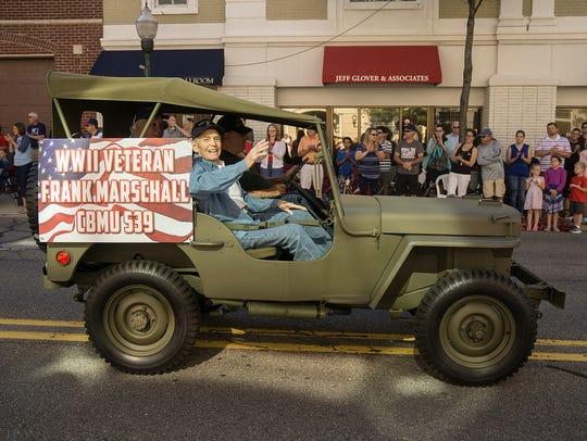 World War II veteran Frank Marschall greets the crowd.