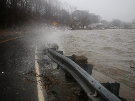 Wind driven rain crashes on to roadway in Stony Point