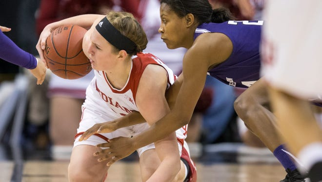 Amanda Cahill (left), of Indiana, gathers a loose ball against Christen Inman of Northwestern, Big Ten Women's Basketball Tournament, Bankers Life Fieldhouse, Indianapolis, Friday, March 4, 2016. Northwestern won 79-73.