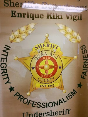 "The emblem of the Doña Ana County Sheriff's Department, headed by County Sheriff Enrique ""Kiki"" Vigil and Undersheriff Eddie Lerma, is seen here."