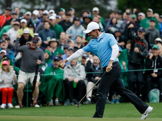 Rory McIlroy, of Northern Ireland, reacts after making a birdie putt on the 18th hole during the third round at the Masters golf tournament Saturday, April 7, 2018, in Augusta, Ga. (AP Photo/Matt Slocum)