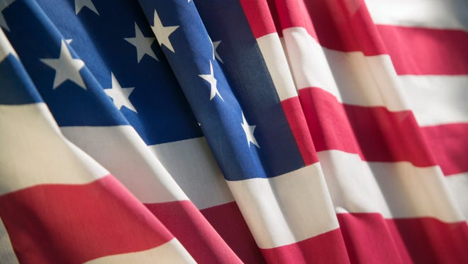 """A North Carolina high school teacher was placed on leave Tuesday after """"stomping"""" on a flag during a lesson, according to local reports."""