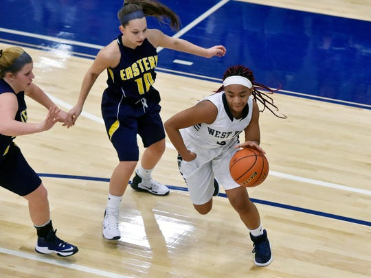 West York's Aryon Williams drives past Eastern York's Katie Lehman in the first half of a YAIAA girls' basketball game Friday, Jan. 6, 2017, at West York. Eastern York defeated West York 55-49.