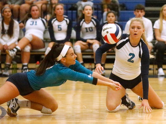 Siegel's Julia Poarch (00) and Emily Bishop (2) go after the same ball during a during a District volleyball match against Blackman, on Wednesday, Oct. 4, 2017, at Siegel.