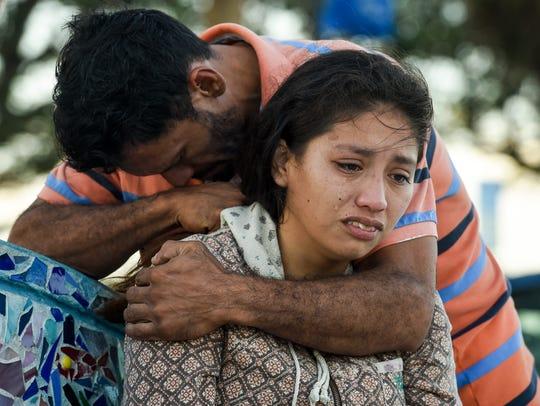 Maria Valladares is comforted by her boyfriend, Claudio