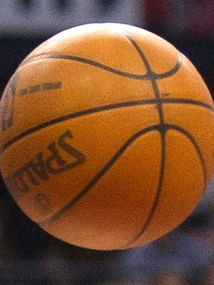 Toronto Raptors forward Aaron Gray, right, battles for the ball against Detroit Pistons forward Greg Monroe during second-half NBA basketball game action in Toronto, Wednesday, Feb. 22, 2012. (AP Photo/The Canadian Press, Nathan Denette)