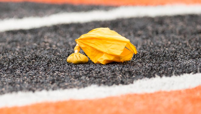 A penalty flag sits in the end zone during the game between the Cincinnati Bengals and Dallas Cowboys at Paul Brown Stadium.