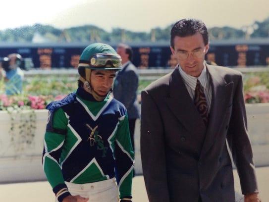 Clint Goodrich talks with jockey Laffit Pincay in this