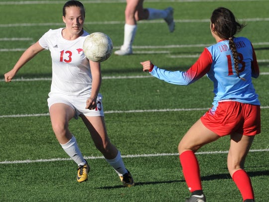 Cooper's Kindyl Wright (13) eyes the ball as Lubbock