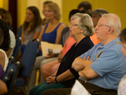 Members of Newark United Methodist Church listen to