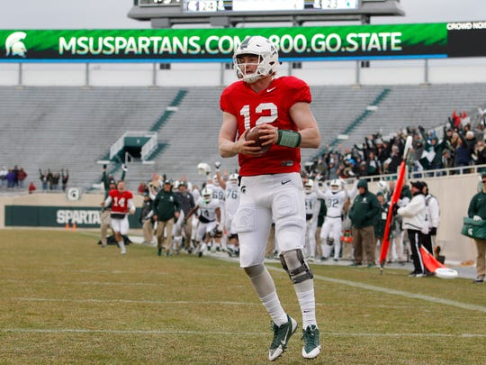Michigan State quarterback Rocky Lombardi reacts after catching a pass for a 2-point conversion on the last play of the spring game Saturday, April 7, 2018 in East Lansing.