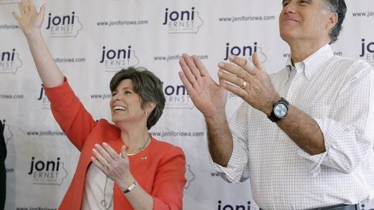 U.S. Senate candidate Joni Ernst with former presidential candidate Mitt Romney in Cedar Rapids earlier this year.
