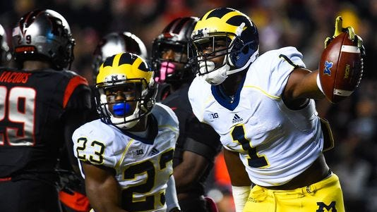 Devin Funchess #1 and Dennis Norfleet #23 of the Michigan Wolverines celebrate a play in the first quarter against the Rutgers Scarlet Knights at High Point Solutions Stadium on October 4, 2014 in Piscataway, New Jersey.