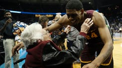 Mar 22, 2018; Atlanta, GA, USA; Loyola Ramblers forward Aundre Jackson (24) hugs Sister Jean Dolores-Schmidt after defeating the Nevada Wolf Pack in the semifinals of the South regional of the 2018 NCAA Tournament at Philips Arena. Mandatory Credit: Brett Davis-USA TODAY Sports ORG XMIT: USATSI-378335 ORIG FILE ID:  20180322_ajw_ad1_142.jpg