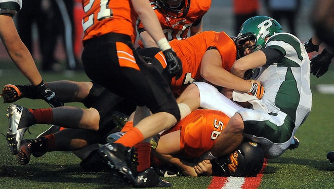Pierre's Brevin Kaiser is taken down by a swarm of Washington defenders during their game at Howard Wood Field on Oct. 1, 2015.