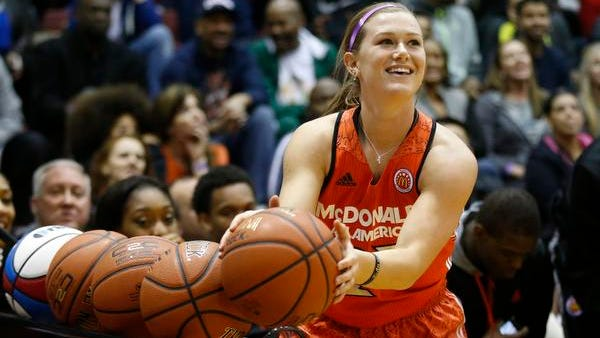 McDonald's East All-American Alexa Middleton (23) from Murfreesboro, Tenn., competes in the girls three point shoot-out during the McDonald's All-American Jam Fest at the University of Chicago in Chicago, on Monday, March 31, 2014. Middleton won first place in the girls three point shoot-out. (AP Photo/Andrew A. Nelles)