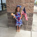 Carrie Young is fourth-generation military kid dressed for the Fourth.