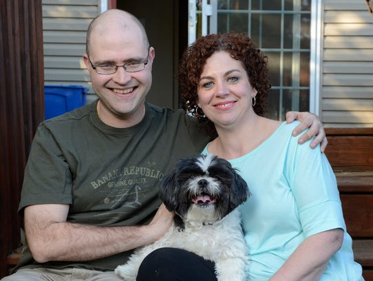 Michael Garcia, 40, his wife, Megan, 39, and their