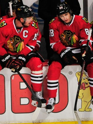 Chicago Blackhawks center Jonathan Toews, left, and right wing Patrick Kane take a break during a timeout.