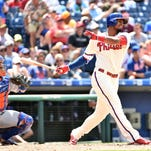 Phillies right fielder Jimmy Paredes strikes out against Jacob deGrom during the sixth inning against the New York Mets at Citizens Bank Park.