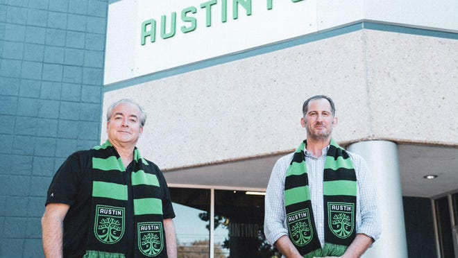 Netspend President Kelley Knutson, left, and Austin FC President Andy Loughnane celebrate Netspend's commitment to being the sleeve sponsor for the jersey of the Major League Soccer team.