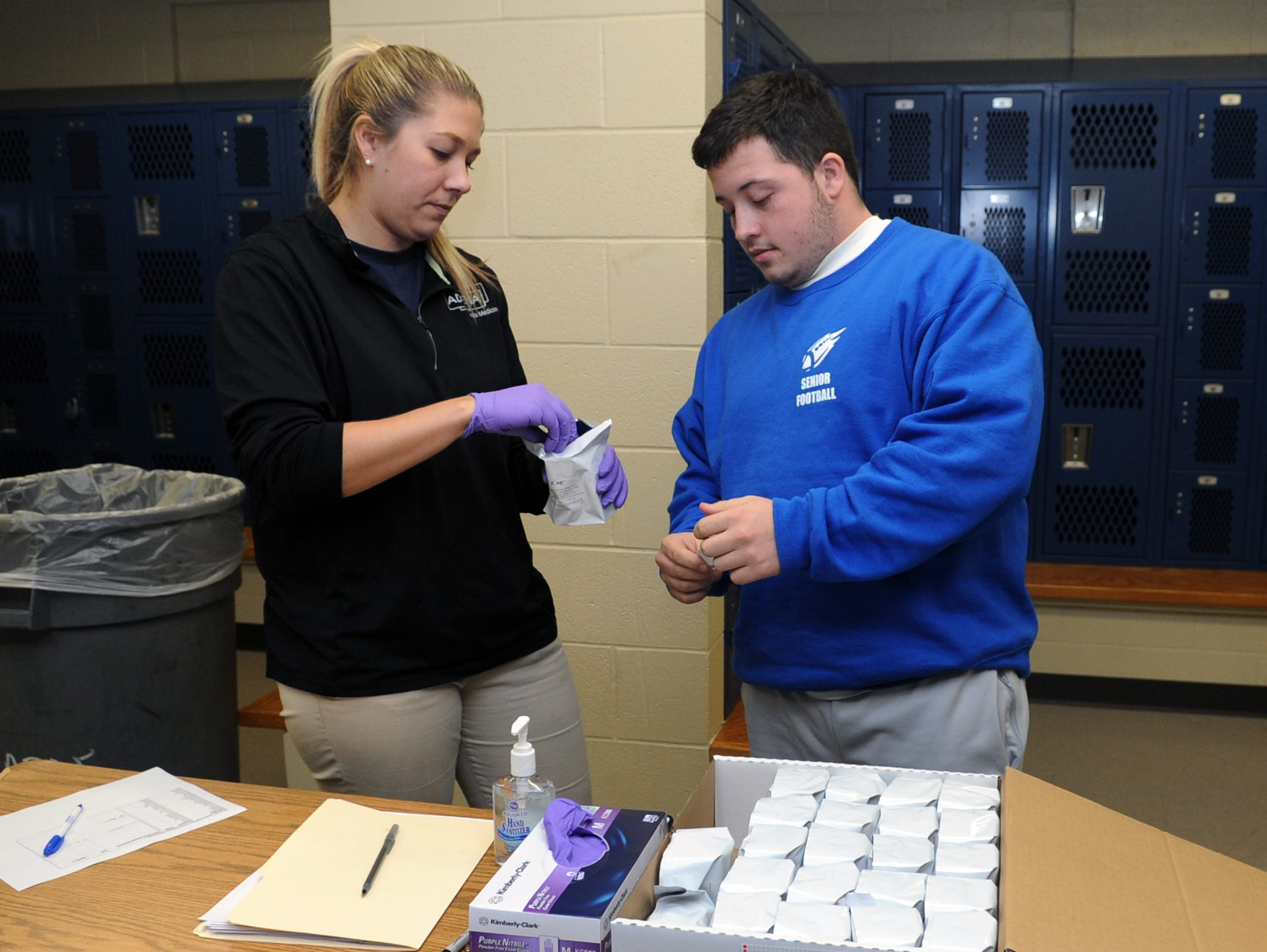 Leo Woods prepares to take a drug test with assistance