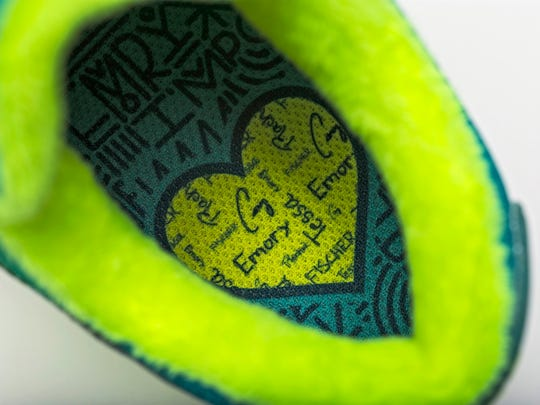 The inside of the Nike shoes designed by Salem 10-year-old Emory Maughan features a heart with the names of her family members.