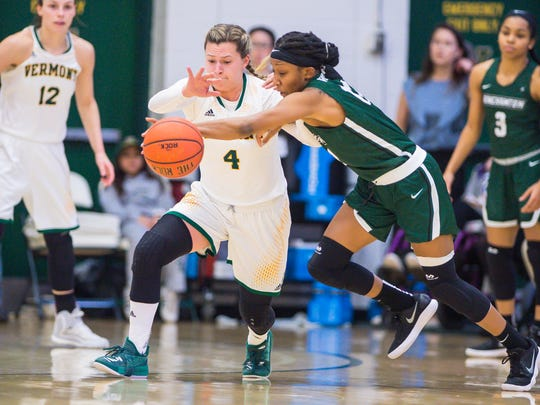 The University of Vermont's Hayley Robertson, left, and Binghamton University's Imani Watkins go after a loose ball in Burlington on Wednesday, January 31, 2018.
