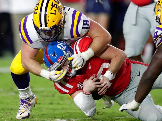 LSU defensive end Christian LaCouture (18) tackles