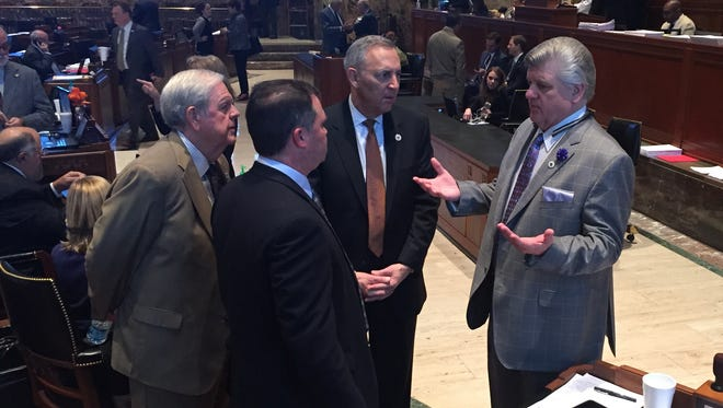 House GOP Caucus Chairman Lance Harris of Alexandria, right, discusses tax bills with Republican Reps. Stephen Dwight, front, Bubba Chaney, left, and Mark Abraham, center.